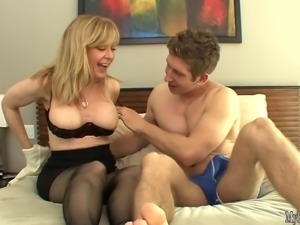 Nina Hartley has graduate sauce sprayed across her big fake titties.
