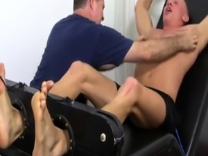 Gay foot fetish young Cristian Tickled In The Tickle Chair
