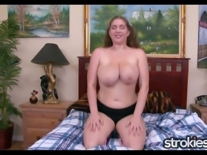 This chubby babe with huge succulent tits is a handjob artist