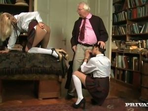 Cherry Kiss and her bestie take turns orally satisfying their teacher's cock