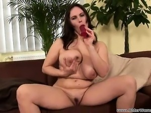 Bodacious housewife Rita drives a dildo in and out of her aching twat