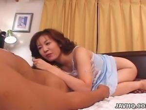 Lusty MILFie housewife Reiko Kamiya tries to tease dude with a nice titfuck