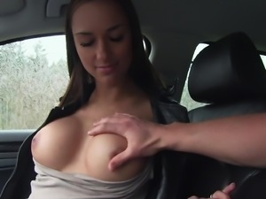 Busty brunette's ride in a car