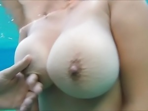 Underwater big nipple pinching