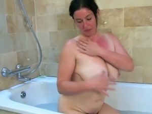 My whorish English wife is washing her tits and hairy pussy