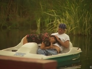 Dru Berrymore rides a guy's cock while being on a lake
