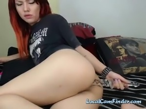 Watch this fiery redhead dildo poke her ass