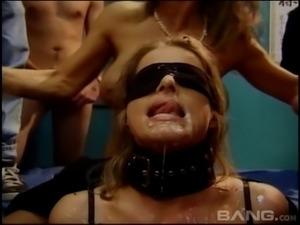 Blindfolded slut opens wide for her bukkake gangbang