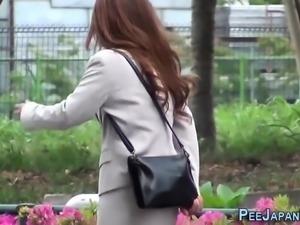 Asian ladies pee outdoors