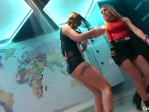 Horny fully clothed girls dancing under the sprinkling shower