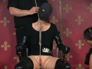 White bitch duct taped to the chair and prepared for BDSM