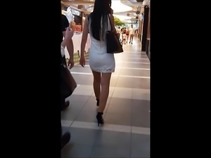 #58 Girl with sexy legs in high heels and white minidress