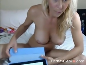 Busty booby blonde milf masturbates her pussy with dildo