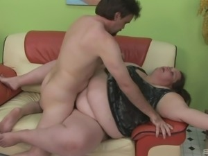 A guy has a crazy threesome with a horny BBW and a midget
