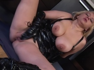 Nikole wears latex lingerie while making her pussy wet