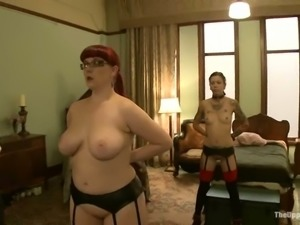 Chubby redhead chick gets toyed and fisted in bondage video