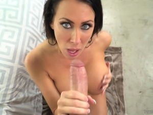 Reagan Foxx has a lot of experience at sucking cock. She looks up at you with...