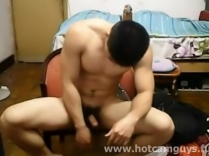 Beefy Chinese hunk takes off his clothes and jerks off his cock on webcam.