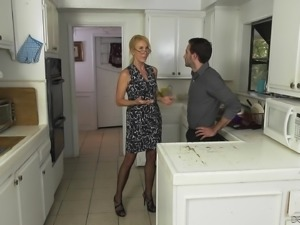 Mature woman Erica Lauren spreads her legs for a fuck in a kitchen