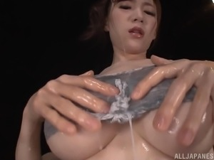 Oiled big natural tits Sumire posing passionately