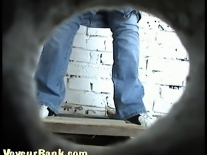 White girl in blue jeans caught on cam pissing in the toilet room