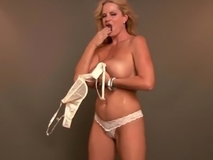 Kelly Madison covered in oil while masturbating with toy