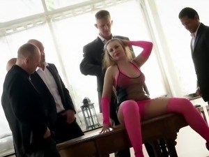 Several well endowed dudes fuck slutty blonde Anica Red right on the table