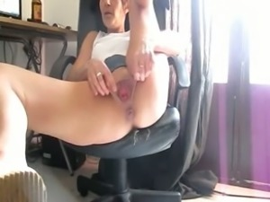 Flexible bitch moans while masturbating on the chair on webcam