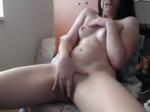 Sitting on the chair buxom pale brunette with juicy ass fingers her wet twat