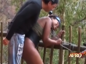 nasty guys are about to smack these african whores in bondage