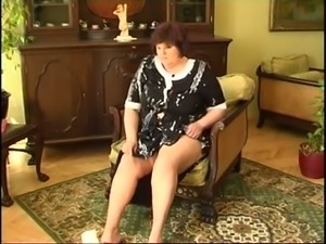 I watch extremely horny fat granny pleasing herself with a dildo