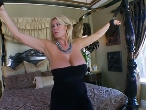 Kelly Madison milks a man's dick while teasing with her tits