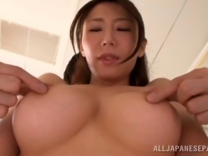 Fantastic Japanese MILF loves having her big soft tits played with