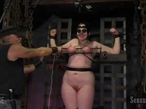 Rose is bound up in the dungeon, being tended to by the incomparable Master...