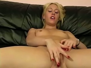Blond haired slender bitch gets rid of her white tank top masturbates herself
