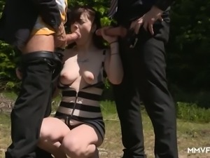 Rich bitch Scarlet Rose finds it awesome to suck two strong cocks at once