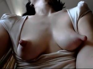 Cute amateur brunette reveals her huge nipples on the webcam