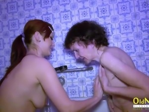 Amateur bathroom footage with naked granny and teen lesbian friend