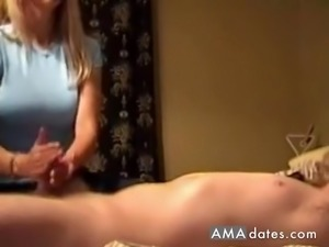 Busty blonde wife has her husband's stiff cock in her hands