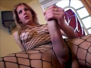 Buxom amateur tranny in fishnets jerks off her long dick