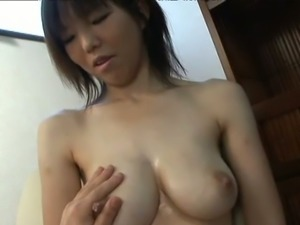 Ugly Japanese whore exposing huge natural jugs