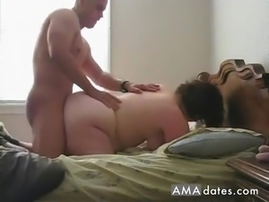 Horny mature gets pounded from behind by a muscular dude in front of a camera.
