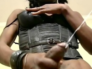 Black leather lingerie looks amazing on the black tranny
