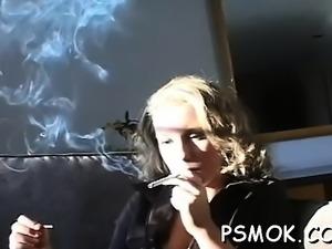 Ebony sucks a small wang while holding a lit cigarette