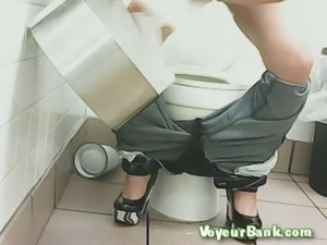 White brunette lady in the public restroom pisses without sitting on the shitter