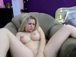 Ebony babe with nice boobs plays with toys
