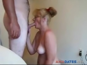 Lovely wife  is on her knees sucking her hubby's dick.