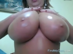 Extremely busty mature lady showing her big tits