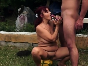 Saggy redhead granny fucked outdoors