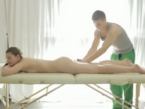 Lying on her sexy flat belly Liona gets her clit and legs massaged